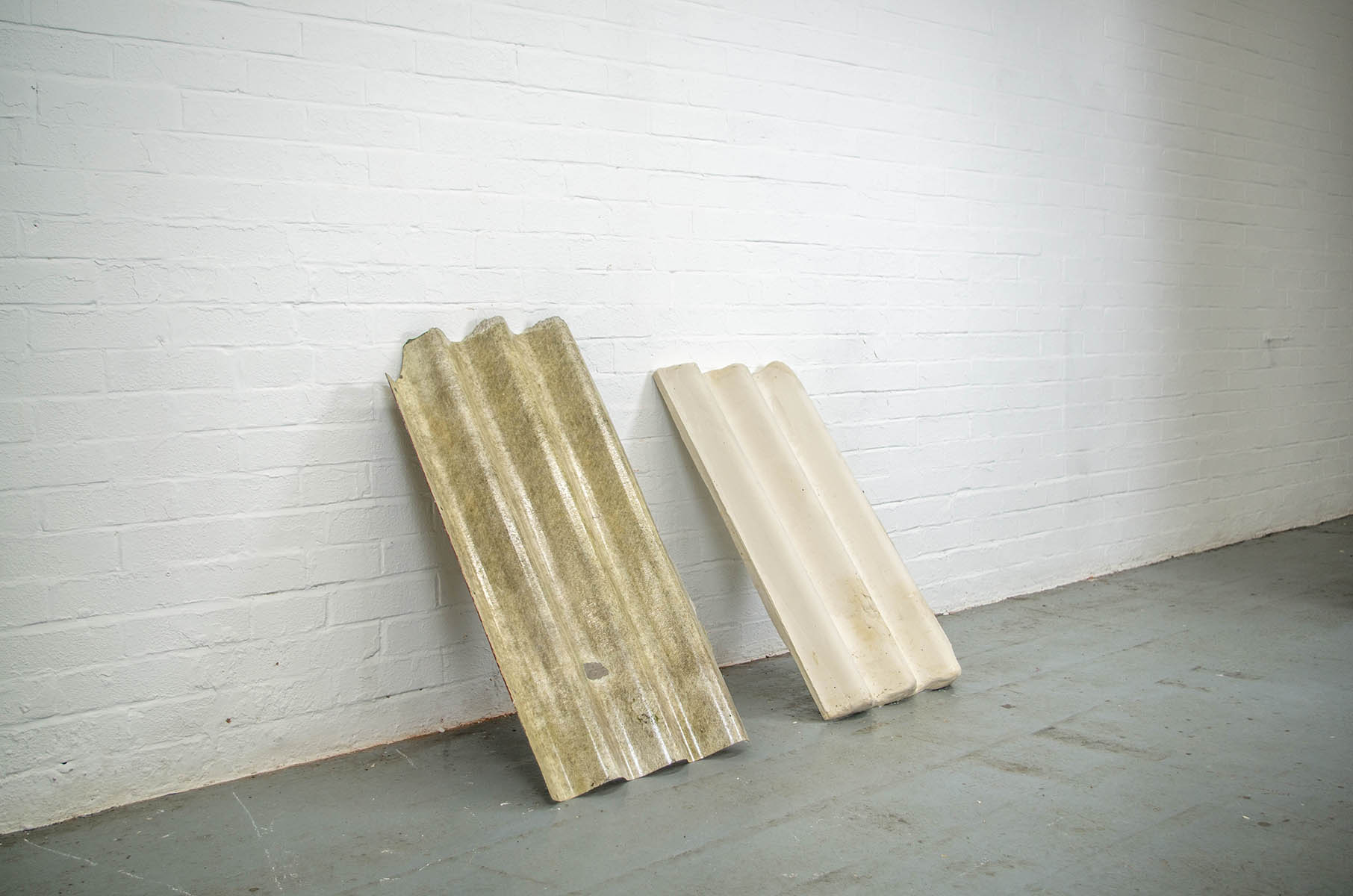 Plaster corrugated roofing sculpture by artist Molly Harcombe