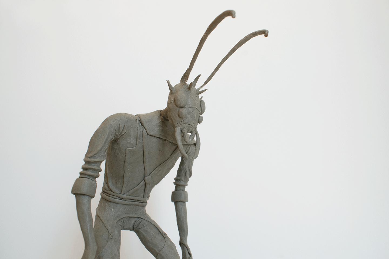 Plastiline sculpture of a creepy anthropomorphic bug character.