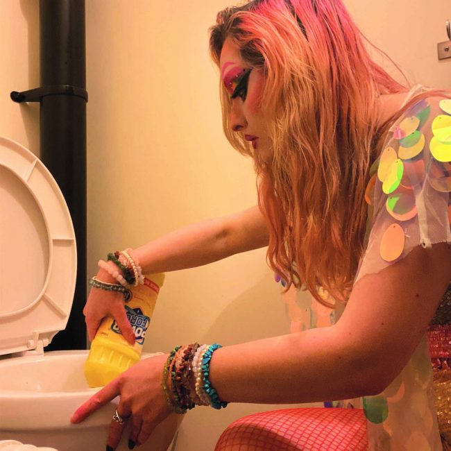 cleaning the toilet in drag